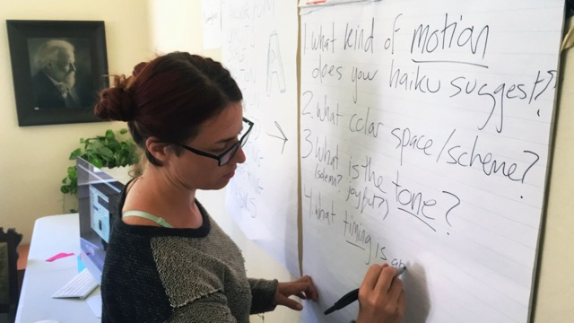 teacher writing on whiteboard